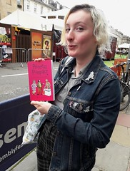 Tue, 08/06/2019 - 14:29 - A new photo for the pose album. It's Em @thursday_grrrl from the punk band @Messed_Up_Youth with a copy of 'Princess Pumpalot: The Super-Farting Bean Mystery'.  #Fart2019