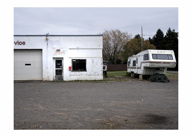 Out of business service station, and camper trailer