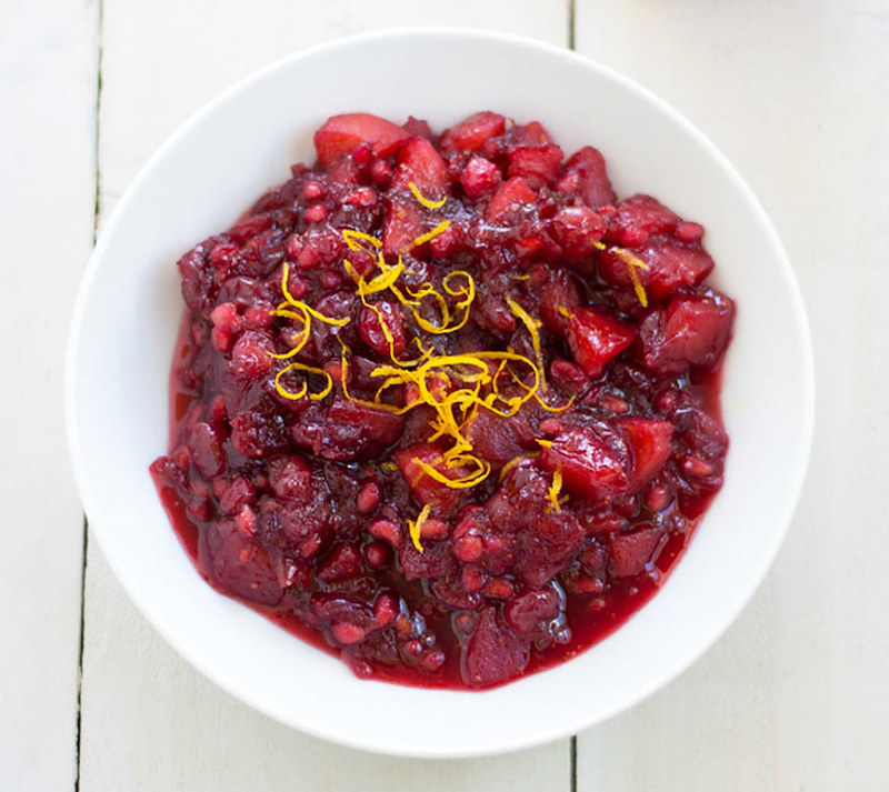 Apple Pomegranate Cranberry Sauce is a festive twist on a classic Thanksgiving side dish. With bright orange zest and fresh cranberries, you'll never want to buy the canned sauce again.