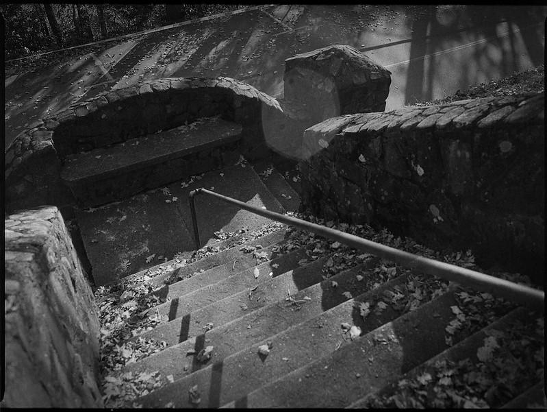 looking down, stairs, stone walls, metal railing, late light, Winsborough Lodge, Montreat Conference Center, Montreat, NC, Mamiya 645 Pro, mamiya sekor 45mm f-2.8, Bergger Pancro 400, Moersch Eco developer, 11.6.19