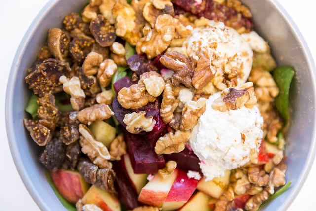 Make Food Goatlovers Bowl with goat cheese, dried figs, apple, beetroot, walnuts, spinach salad, pick salad and raspberry maple dressing