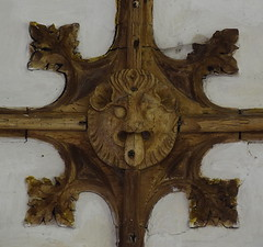 chancel boss: lion with its tongue out