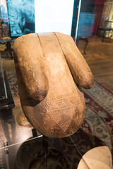 Carving of a woman's belly showing ritual scarification