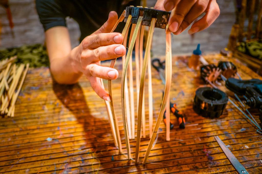 Attaching bamboo sticks to Hoi An Lanterns