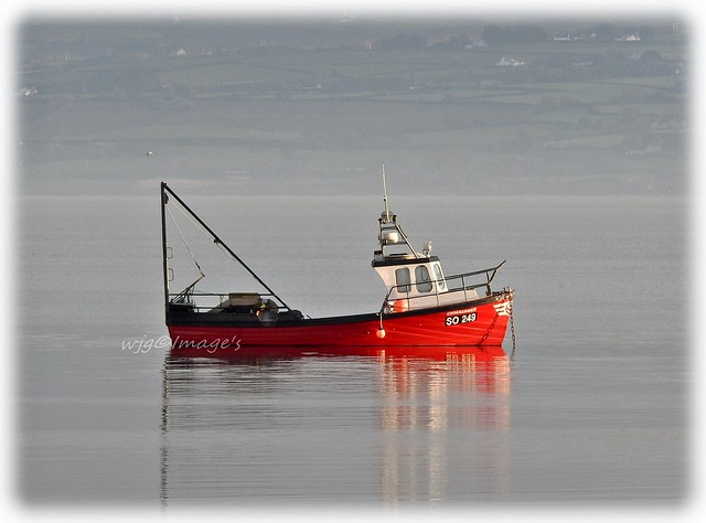 Red boat on the river, Lough Foyle, Co. Donegal.