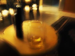 Sipping whiskey, waiting for a call. Still life study.