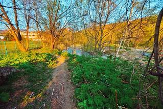 Закат. Вдоль лесного ручья, Санта Резот отель (слева на заднем плане) / Sunset. By forest creek, Santa Resort hotel (at the left/background). Yuzhno-Sakhalinsk, Sakhalin island