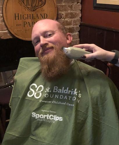 Trey Tucker has his head and beard shaved.