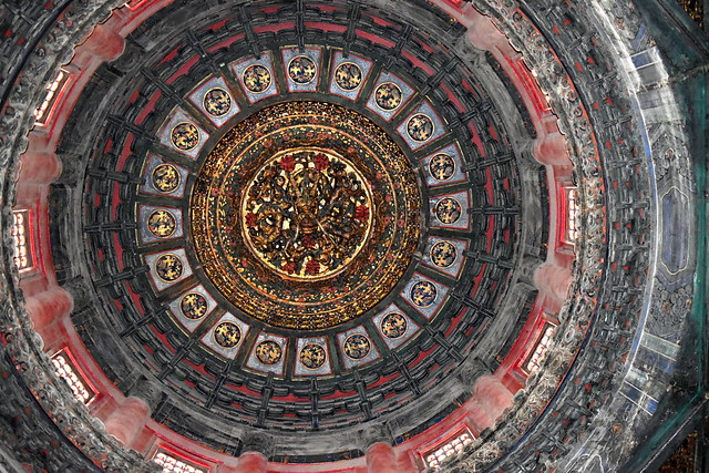 Old Chinese dragon wooden dome carved and colored on Wanchunting pavilion of the Forbidden City palace imperial garden, Beijing, China
