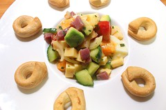 SALAD OF SMOKED BEEF, GOUDA, EGG, AVOCADO, CUCUMBER AND TOMATO IN HERB VINAIGRETTE, SERVED WITH TARALLI