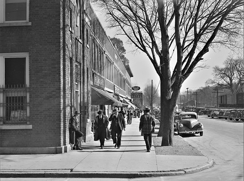 Just Off Main: Sidewalk traffic on main street on the day of tobacco auctions in Mebane, North Carolina. November 1939.