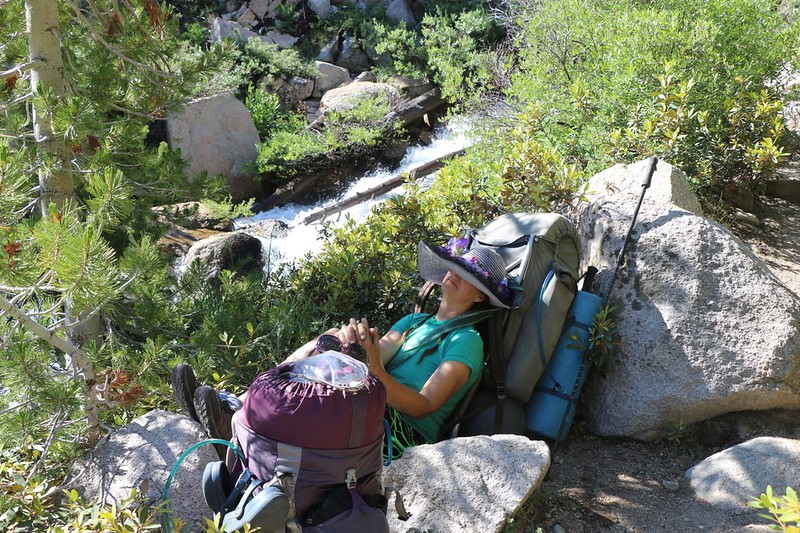 Vicki takes a nap on the Kearsarge Pass Trail next to Independence Creek - it recharges her battery