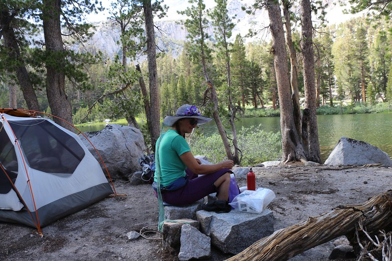 Vicki cooks up some early dinner in the afternoon at Flower Lake while the weather is still warm