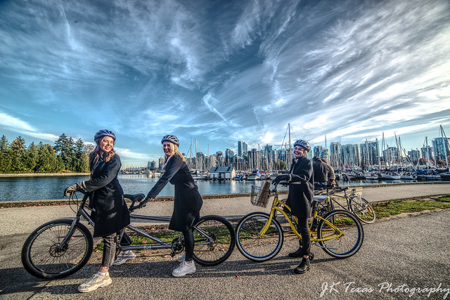 3 adorable ladies on bikes at Stanley Park in Vancouver British Columbia