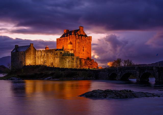 A dramatic blue hour at the 13th century Eilean Donan Castle in the Scottish Highlands.