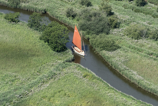 Dreamtime 30' Traditional Norfolk Broads Sailing Yacht - sailing along Meadow Dyke linking Hickling Broad to Horsey Mere - Norfolk Broads aerial image