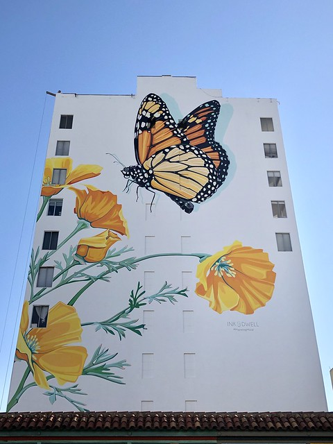A butterfly in the Tenderloin. Three weeks ago I posted a picture of this mural being painted; it's now completed.