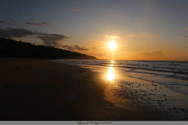Coucher de soleil et reflets sur la plage de Villerville .