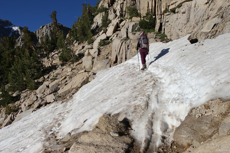 Traversing some residual snow on the Kearsarge Pass Trail at 11,000 feet elevation