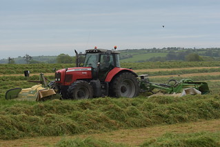Massey Ferguson 6499 Tractor with a Krone EasyCut Front Mower Conditioner and Samasz Rear Mower Conditioners