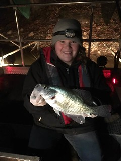 Photo of young woman holding a crappie