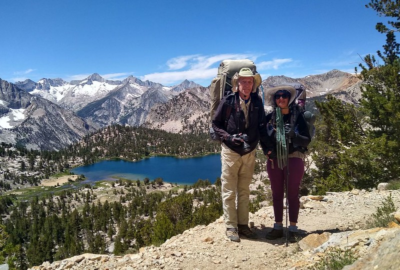 Timer shot using my phone camera of the two of us posing with Bullfrog Lake on the Kearsarge Pass Trail