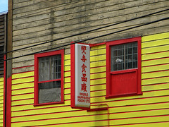 Yellow building with red trim in Vancouver, Canada