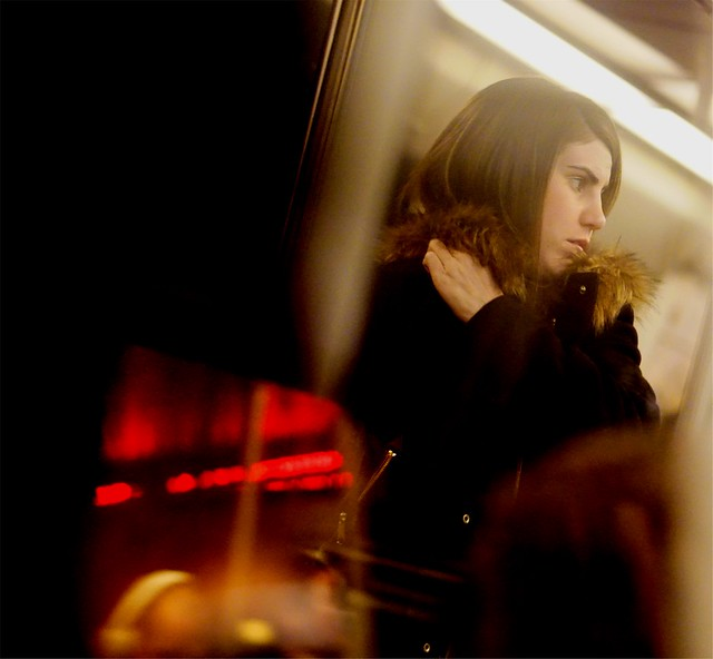Candid Photography - Reflections in a Metro Window