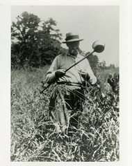 Henry R. Carter, the yellow fever expert of the Public Health Service, collecting mosquito larvae at Baden Pond in North Carolina