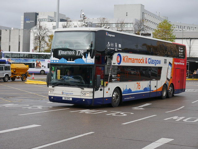 Stagecoach Western Van Hool TD927 Astromega 511OHU 50242, reregistered from CN61FBD, in route X76 livery, operating service X76 to Kilmarnock departing Buchanan Bus Station, Glasgow, on 2 November 2019.