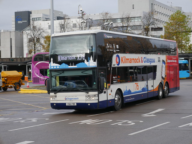 Stagecoach Western Van Hool TD927 Astromega CN61FBE 50243, in route X76 livery, operating service X76 to Kilmarnock departing Buchanan Bus Station, Glasgow, on 2 November 2019.