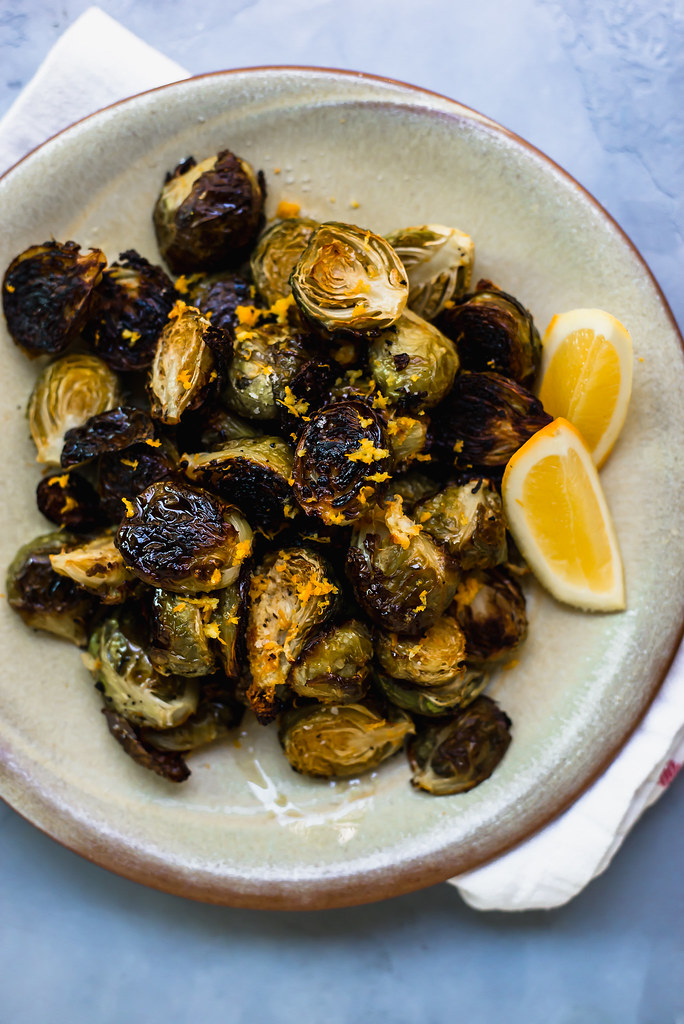 A staple on the holiday table, roasted brussels sprouts flavored simply with bright lemon zest, spicy garlic and rich olive oil.