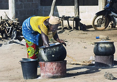 And the owner of a roadside restaurant washes out her cooking pots.