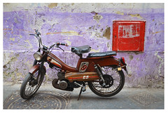motorbike in front of purple wall