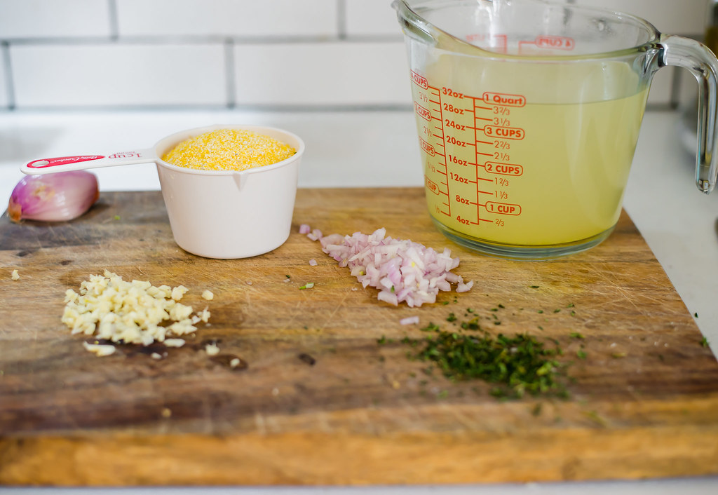 Ingredients for creamy polenta are shallots, garlic, cornmeal, stock, fresh thyme and grated Parmesan.
