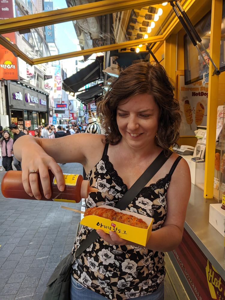 putting chili sauce on a cheddar-stuffed deep fried hotdog = delicious