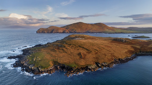 kerry valentia island se atlantic wildatlanticway sea ocean land mountains rocks doulushead beginish drone aerial dawn sunrise glow