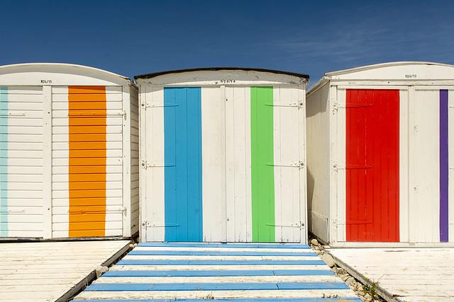 Three colored beach huts