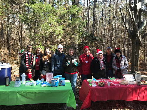 Volunteers ready to serve visitors with cookies, hot cocoa, and s'mores.
