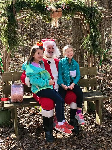 Children visiting with Santa Claus.