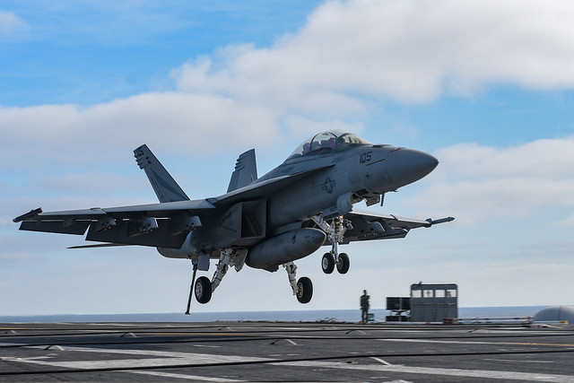 "PACIFIC OCEAN (Nov. 13, 2019) An F/A-18F Super Hornet, assigned to the ""Black Knights"" of Strike Fighter Squadron (VFA) 154, makes an arrested landing on the flight deck of the aircraft carrier USS Theodore Roosevelt (CVN 71). Theodore Roosevelt is conducting routine operations in the Eastern Pacific Ocean. (U.S. Navy photo by Airman D.J. Schwartz/Released)"