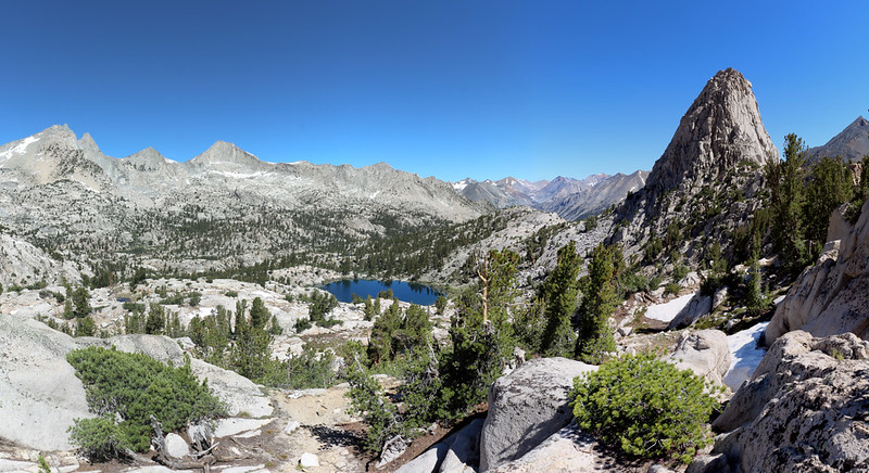 Panorama view looking down into the 60 Lakes Basin, with Fin Dome on the right