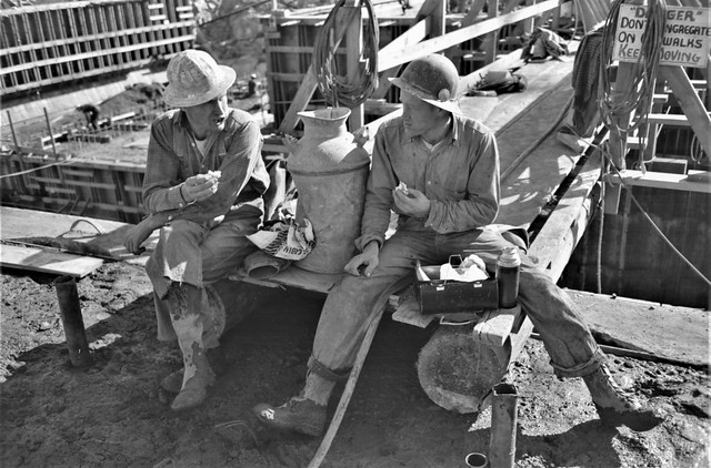 Between Bites: Construction workers eating lunch on the Shasta Dam. Shasta County, California, November 1940.