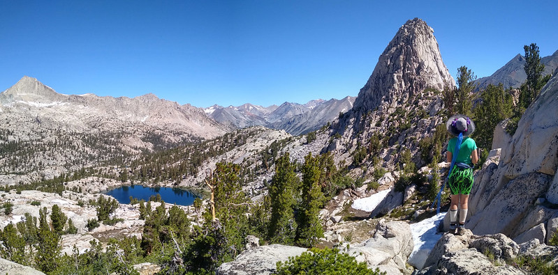 Panorama shot of the 60 Lakes Basin, Fin Dome, and Vicki in her wild shorts