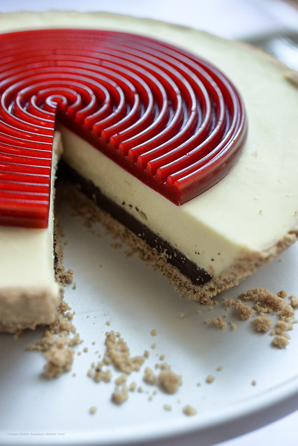 No bake Vanilla cheesecake with chocolate ganache and Raspberry Jelly disc