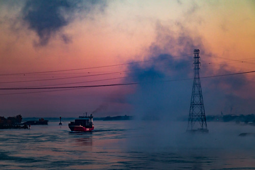 canada morning quebec stlawrenceriver sunrise water containership fog mist ship shoreline