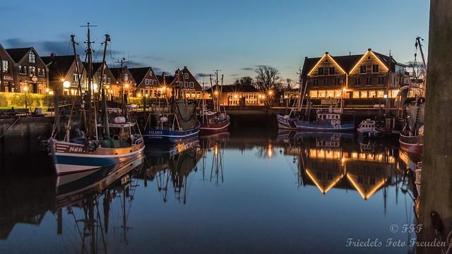 The harbor of Neuharlingersiel in the evening glow of light