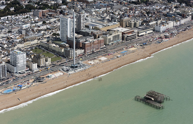 Brighton seafront & the burnt out remains of the old West Pier - aerial image