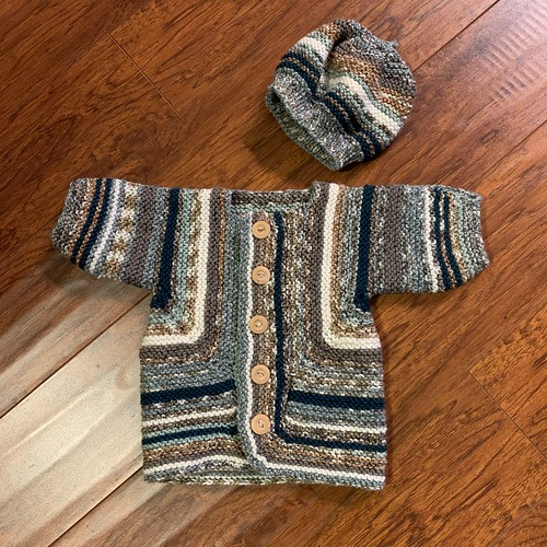 Paulette has knit another Baby Surprise Jacket by Elizabeth Zimmerman with a matching hat!