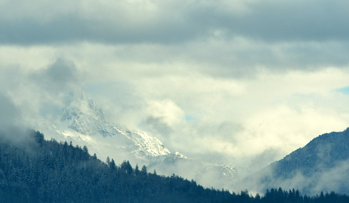 THE WINTER MISTS LIFTING TO SHOW RUGGED MOUNTAIN PEAKS ON THE HOPE PRINCETON HIGHWAY,  NORTH CASCADES,  B.C.